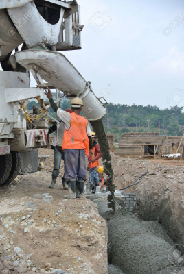 38599947-Group-of-construction-workers-pouring-concrete-from-concrete-mixer-to-casting-monsoon-drain-wall--Stock-Photo.jpg