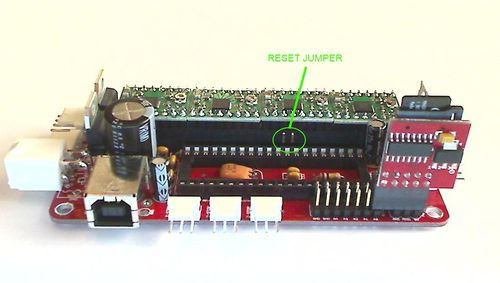 alt SDSL card mounted on a Sanguinololu board. Highlighted is the jumper that needs to be open in order for the Sanguinololu not to reset when the USB is disconnected. The ATMEGA chip is removed in this picture inorder to clearly show the reset jumper.