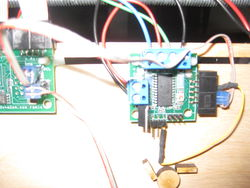 This photo shows the cable going from the SDA/SCL of the mainboard to the ten pin connector on the stepper controller, it also shows the wire used to enable the stepper controller