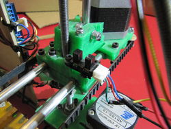 Install the X Axis endstop and flags